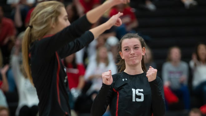 Lake Travis outside hitter Jamison Wheeler celebrates a kill with middle blocker Campbell Cook in a playoff match against Cibolo Steele last season. Wheeler, who has  824 career kills for the Cavs, returns as one of the team captains for a loaded Lake Travis team.