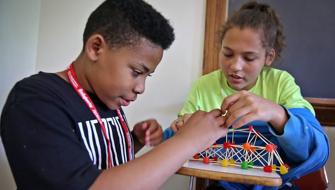 Kameron Milton, left, and Ysabell Braden work together to build a model of a bridge during the Horizons non-profit summer education program at Butler University, Tuesday, June 21, 2016.  Classmates team up to design and build the models, and in several weeks they will help build a bridge from one of the designs, on the Butler campus.