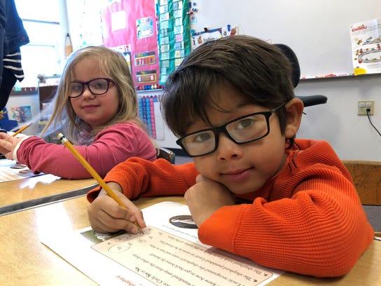 Allison Cords and Matthew Shiokawa, students at Fond