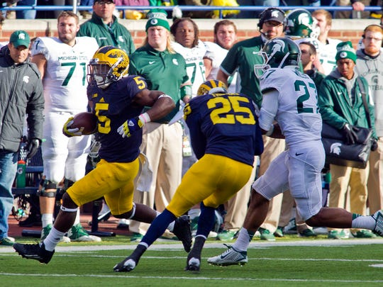 Michigan's Jabrill Peppers returns a punt as defensive back Dymonte Thomas (25) puts a ferocious block on Michigan State safety Khari Willis in the second quarter Saturday in Ann Arbor. At this point, Tyler O'Connor's short punts weren't just costly, they were dangerous.