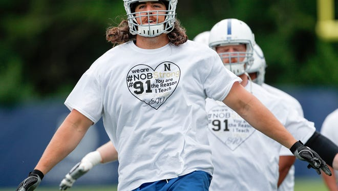 Indianapolis Colts offensive tackle Anthony Castonzo and his teammates wear teeshirts honoring Jason Seaman and Ella Whistler during the teams organized team activities their at the Colts complex on Wednesday, May 30, 2018.