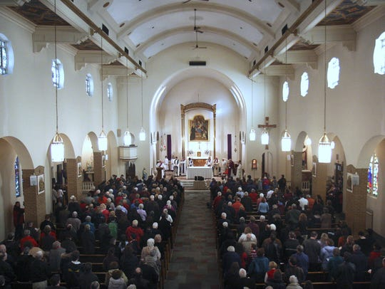 Deacon John Fitch speaks during the final Mass at Holy Rosary Church on March 9, 2008. A drop in parishioners forced the Diocese of Rochester to close the parish, which during its heyday had more than 800 families.