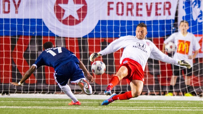 Indy Eleven's Kristian Nicht (24) blocks the shot of Carolina Railhawk's Daniel Jackson (17) during first half action. Indy Eleven hosted the Carolina Railhawks in NASL soccer action, Saturday, September 27, 2014, at Michael A. Carroll Track & Soccer Stadium in Indianapolis.