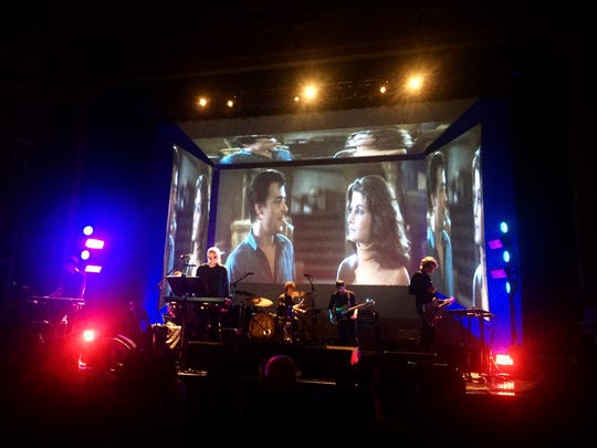 """John Carpenter and his band, performing the score to """"Assault on Precinct 13"""" on July 9 at the Keswick Theater in Glenside, Pennsylvania."""