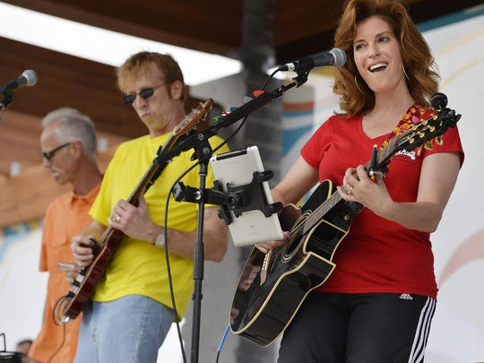 "Janelle Kendall (right) belts out a version of the Eagles' ""Life in the Fast Lane"" with the band Walter's Wheelhouse at a Summertime by George! concert."