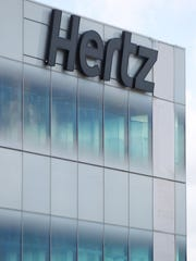 The sign on the Hertz Global Headquarters on Williams