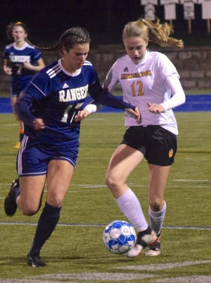 Traip Academy's Sophia Santamaria, left, defends against Maranacook's Addie Watson during their Class C South championship match in Lewiston, Maine, last fall.