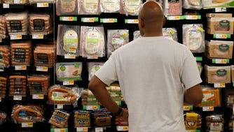 Neal Williams, of Clifton, browses Kroger's Simple Truth deli meat in a display at Kroger in Newport, Ky., on Tuesday, July 18, 2017.