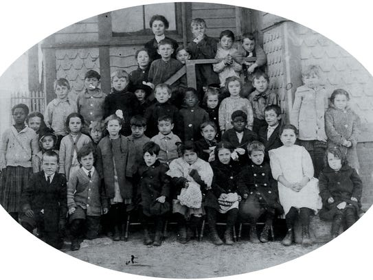 Class photo from the 1912-13 school year, includes