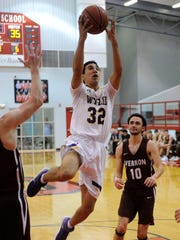 Wylie's Payton Brooks (32) goes into the air for a