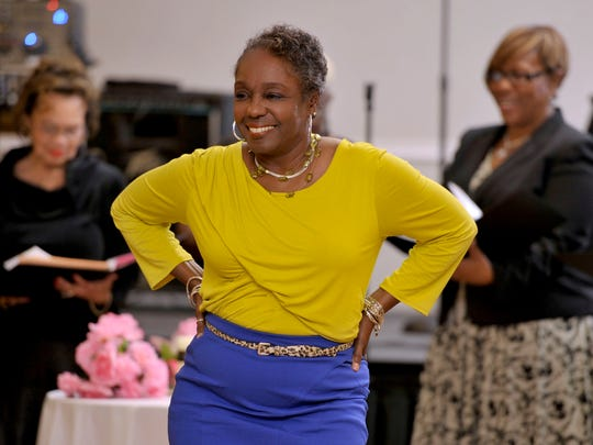 Jeanette Gatlin sashays across the dance floor, moving to the words celebrating the empowerment of women by black females poets as read by the women in the background during Mamie's 10th Annual Girlfriends' Gathering Wednesday night at New World Landing.