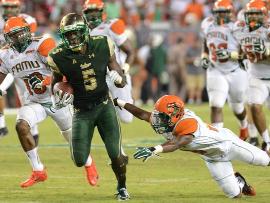 Sep 5, 2015; Tampa, FL, USA; South Florida Bulls running back Marlon Mack (5) runs the ball during the second half against the Florida A & M Rattlers at Raymond James Stadium. Mandatory Credit: Jonathan Dyer-USA TODAY Sports