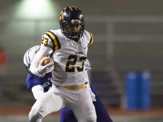 Avon senior Isaac Guerendo (23) rushes the ball up