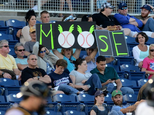 "Pensacola Blue Wahoos fans cheer on Travis ""Moose"" Mattair on Monday during a game against the Jacksonville Suns at Blue Wahoos stadium."