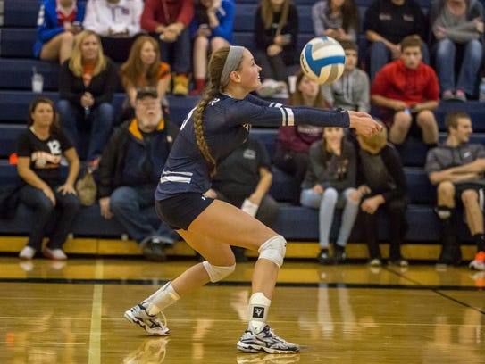Marysville's Samantha Miller digs the ball during a