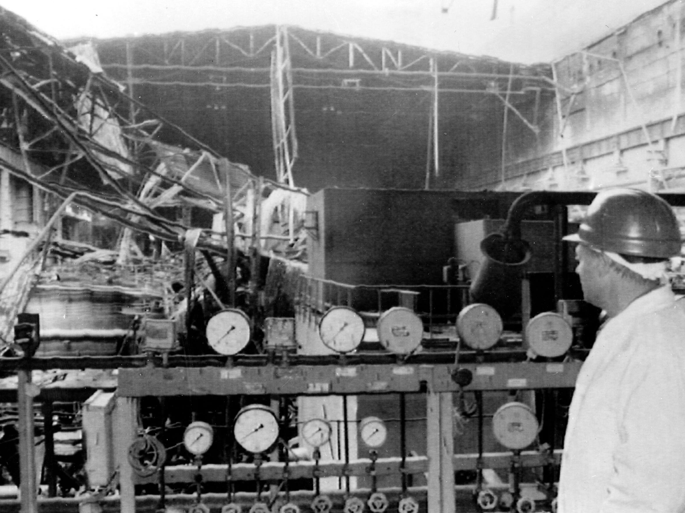 An engineer inspects the damage of the machine room at reactor two of the atomic power plant in Chernobyl, Russia, on October 13, 1986.