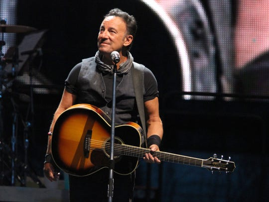 Bruce Springsteen takes the stage with the E Street