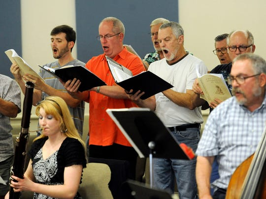 Performers rehearse J.S. Bach's Passion of St. John Saturday at Christ Lutheran Church. Limuel Forgey is the music director.