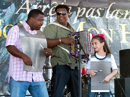 Chubby Carrier, center, and the Bayou Swamp Band entertain, with a special guest, at the 2015  Festivals Acadiens et Creoles In Lafayette.