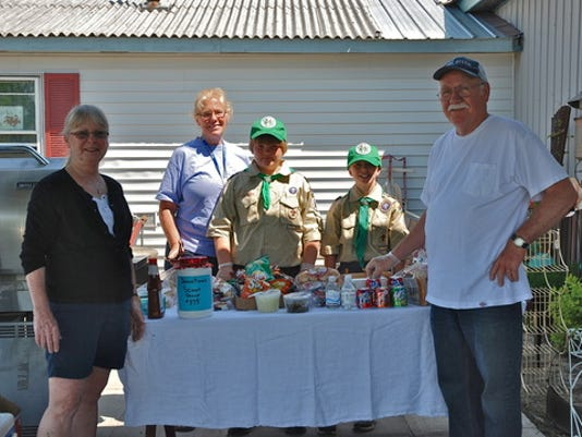 Owners of The Carriage Place, Betty and Gil Glidden, with Boy Scout Troop #375. provided photo