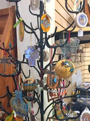A tree decorated with southwestern-style holiday ornaments are eye-catching items at the Deming-Luna-Mimbres Museum Gift Store.