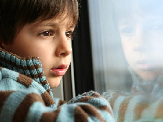 Little Boy Looking out of a Window