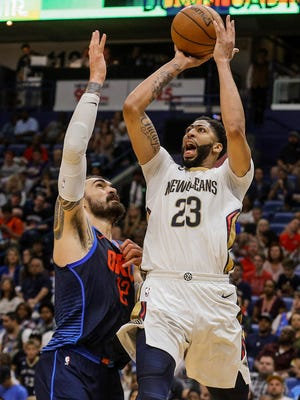 New Orleans Pelicans forward Anthony Davis (23) shoots over Oklahoma City Thunder center Steven Adams (12) during the second half at the Smoothie King Center.