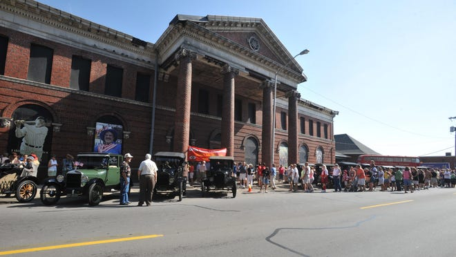 People line up along North E Street to tour the inside of the former Pennsylvania Railroad Depot during the groundbreaking event to mark the start of renovations of the building in July 2010.