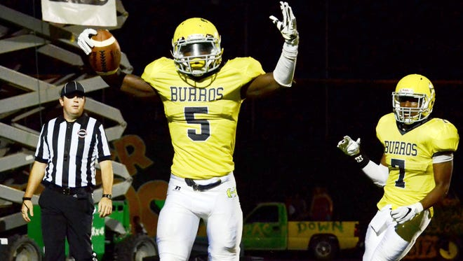 Hillsboro junior Malique Fleming (5) celebrates after scoring a second-quarter touchdown during Friday's game against Region 6-5A foe Hendersonville.