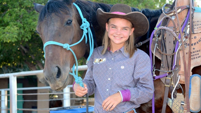 Eleven year old Teagan Miller of Artesia, standing with Tilly prior to Saturday's Amateur Barrel Racing finals at Eddy County Sheriff's Posse Arena, will be one of 60 competitors in the Junior National Rodeo Championships this December in Las Vegas, Nev.