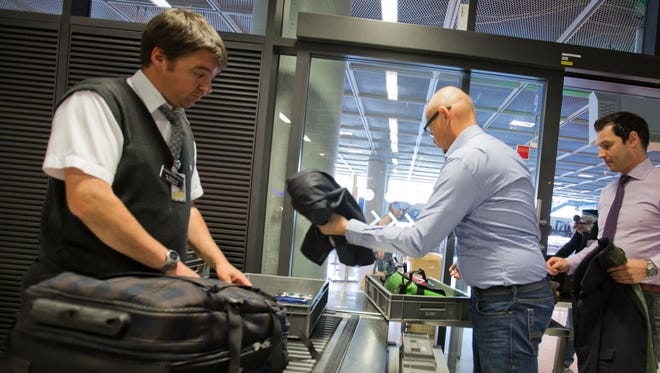 Travelers pass through the security checkpoint at an airport in Frankfurt, Germany on July 3.