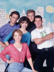 "Lea Thompson, front, Amy Pietz, center, Eric Lutes, back from left, Malcolm Gets and Andy Lauer in a 1996 promotional photo from the NBC sitcom  ""Caroline in the City."""