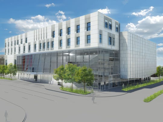 The nearly 190,000-square-foot Voxman Music Building is under construction at the corner of Clinton and Burlington streets, and will include a second-floor balcony facing downtown, a 700-seat concert hall, a 200-seat recital hall, as well as classrooms, rehearsal spaces and faculty studios.