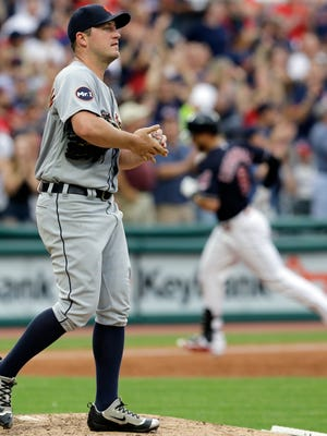 Tigers pitcher Jordan Zimmermann waits for Indians third baseman Lonnie Chisenhall to run the bases after Chisenhall hit a two-run home run during the third inning Friday in Cleveland.