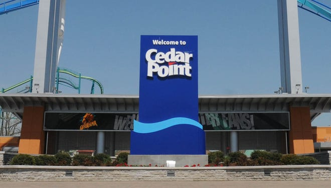 The GateKeeper twists above the entrance to Cedar Point in 2013.