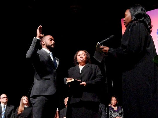 Mayor Adrian Perkins says the oath as his mother, Johnny Oliver-Jones, holds a bible during his Inauguration at the Shreveport Convention Center Saturday, Dec. 29, in Shreveport, Louisiana.
