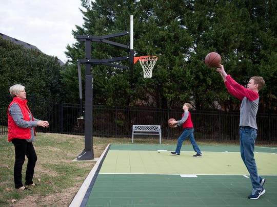 Alex Koch plays basketball with his brother at their