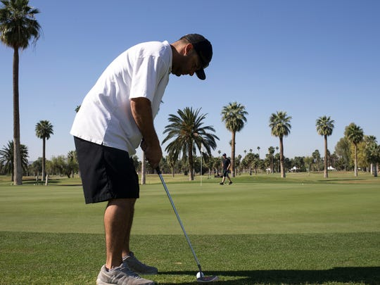 Danny Powers putts on the 1st green at Encanto Golf