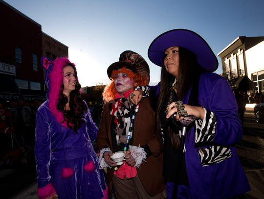 Natalie Cambridge, left, Lu Cambridge and Misha Willie wait their turn to enter the annual custom contest Tuesday during Boo-Palooza in downtown Farmington.