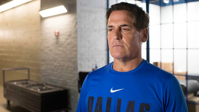 Dallas Mavericks owner Mark Cuban is interviewed during the Mavericks media day at the American Airlines Center.