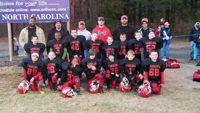 The Carolina Warriors 8 and under football team.