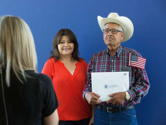 Rafael Serrano, a new U.S. citizen, stands with his