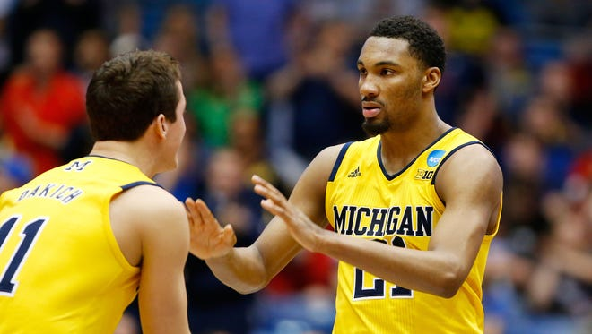 Zak Irvin and Andrew Dakich of the Michigan Wolverines.