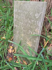 An old gravestone in the Clarke Cemetery marks the grave of Otis Peckham, who died in 1849.