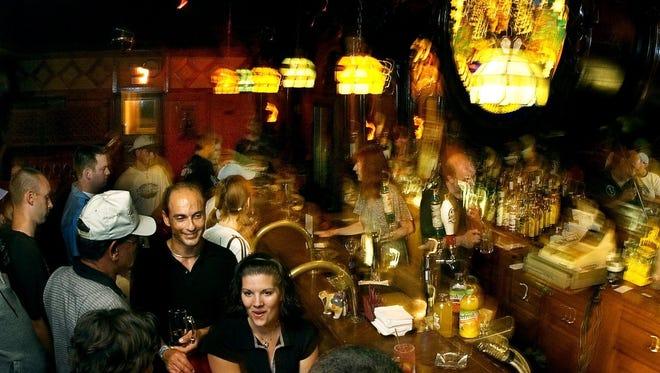 - Stober's Bar patrons enjoy a drink at the bar, Aug. 7, 2004 in Lansing.