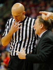 Michigan State Spartans head coach Tom Izzo has a discussion