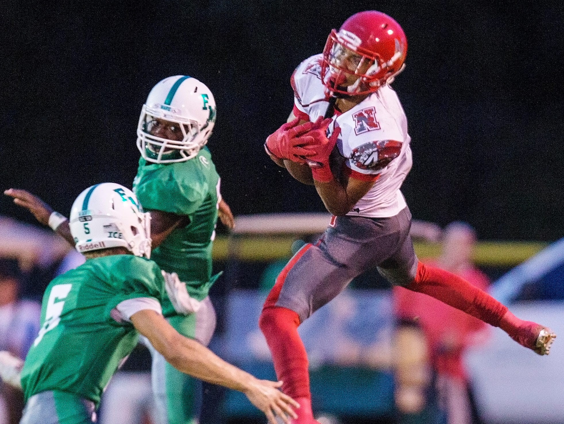 North Fort Myers High School's Joe Wilkins catches a pass against Fort Myers during first quarter play Friday at Fort Myers High School.
