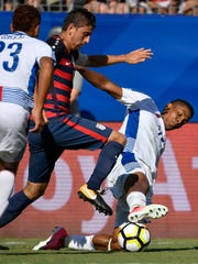 United States midfielder Alejandro Bedoya (11) and Panama forward Miguel Camargo (18) battle for the ball during the second half of a CONCACAF Gold Cup soccer game at Nissan Stadium Saturday, July 8, 2017, in Nashville, Tenn.