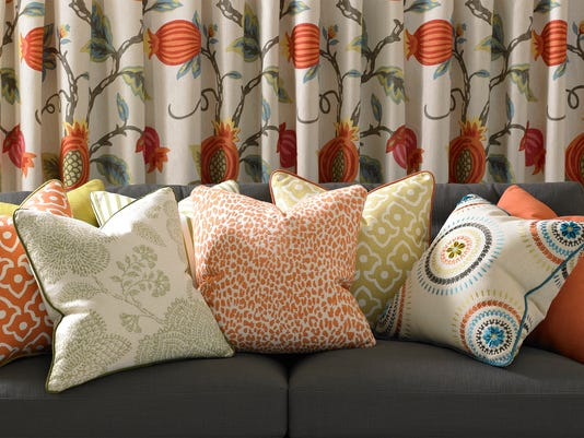 Ikats, chevrons, paisleys, and Asian influence are trendy as in these fabric.jpg