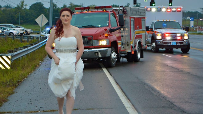 Montgomery County Emergency Medical Services paramedic Sarah Ray is photographed at the scene of a wreck on her wedding day. The photo, taken by her mother, has gone viral.